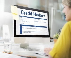 Women at computer regarding her credit history
