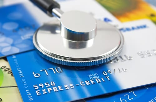 stethoscope on credit card