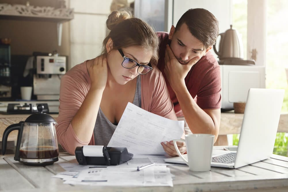 couple evaluating bills