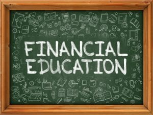 Financial Education hand drawn on chalkboard with doodle icons around.